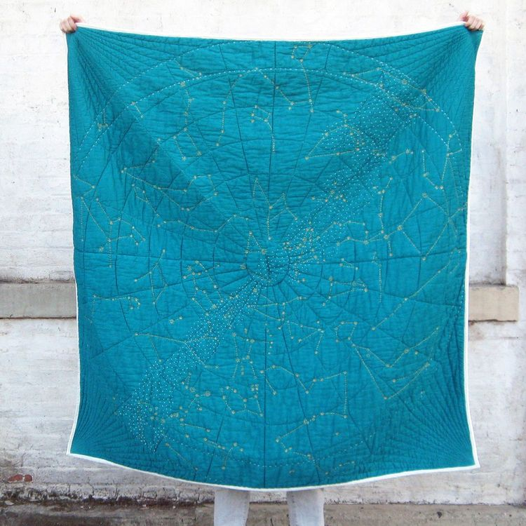 Bold quilt with carefully stitched stars and constellations