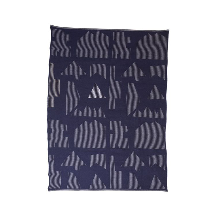 Blue and grey throw blanket with geometric details