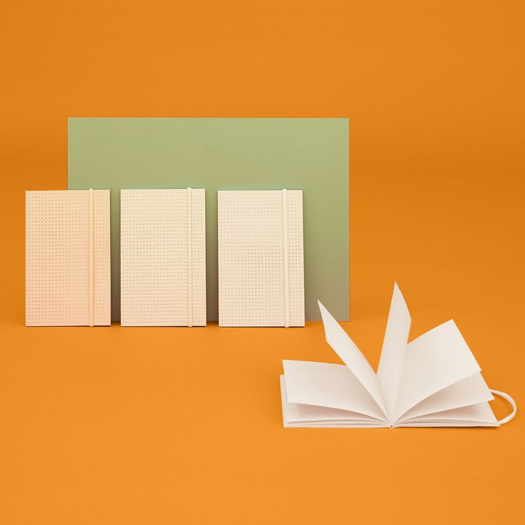 Perforated notebook with blank pages and bookmark