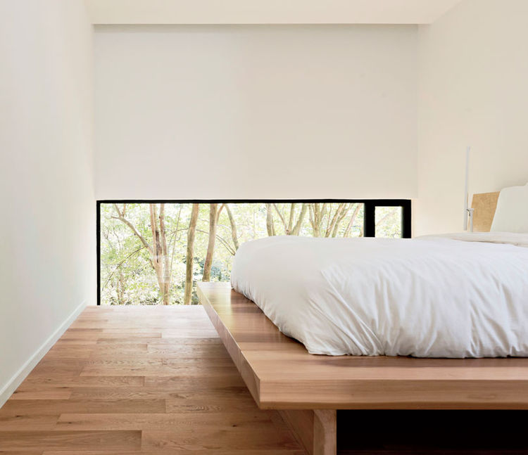 Modern Texas home master bedroom with poplar bed platform