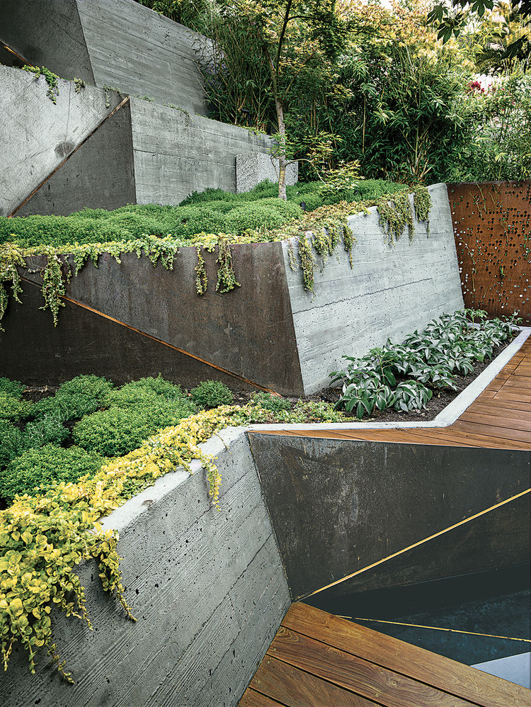 modern landscaping terrace concrete wall ramps ipe deck