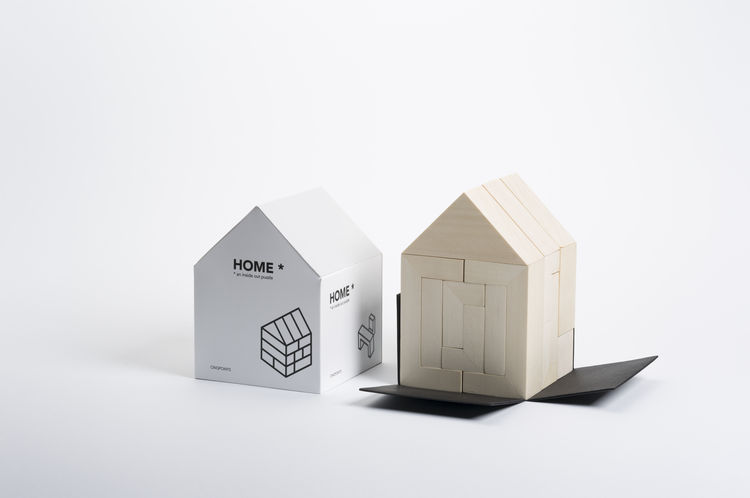 3D Architectural puzzle in the shape of a house