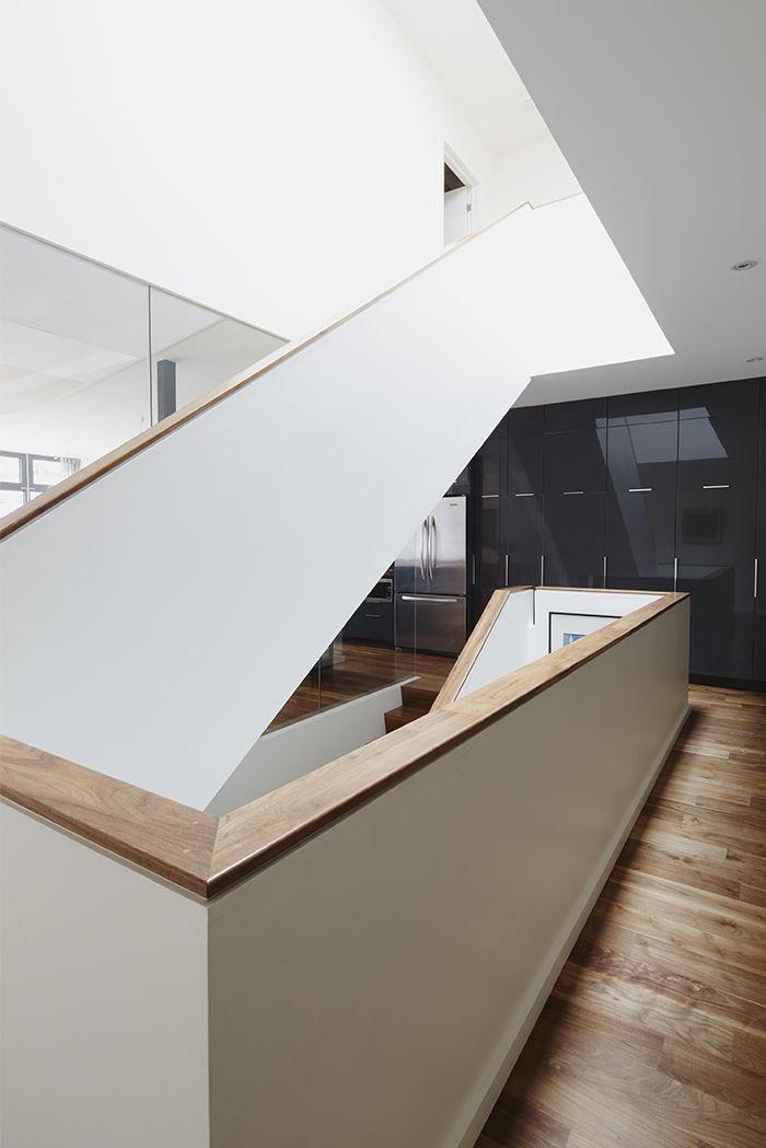 Renovation Montreal staircase skylight walnut flooring.