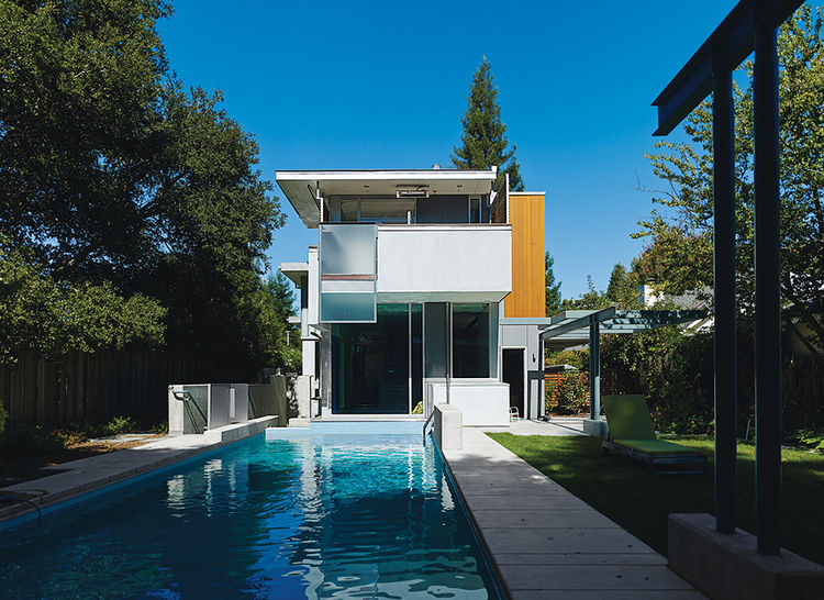 Palo Alto home facade with swispearl siding, concrete flooring and walls and a pool in the backyard