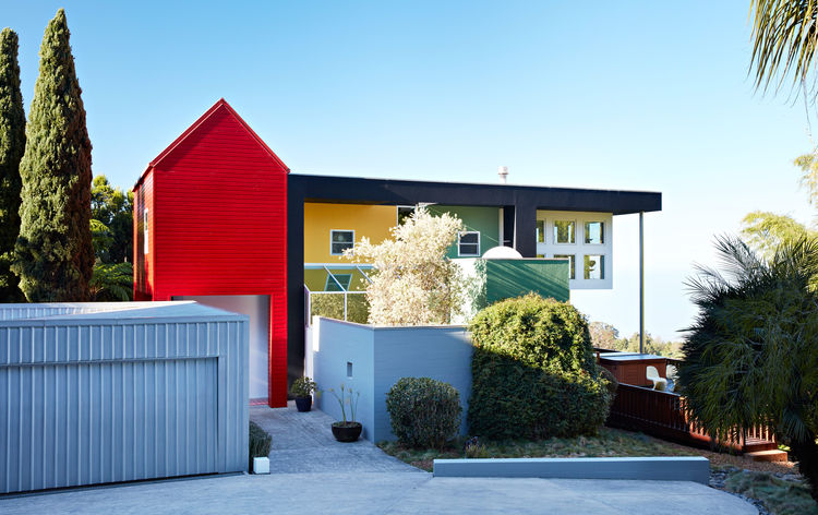 A collage of brightly colored geometric volumes comprise the Ettore Sottsass–designed residence of Lesley Bailey and Adrian Olabuenaga