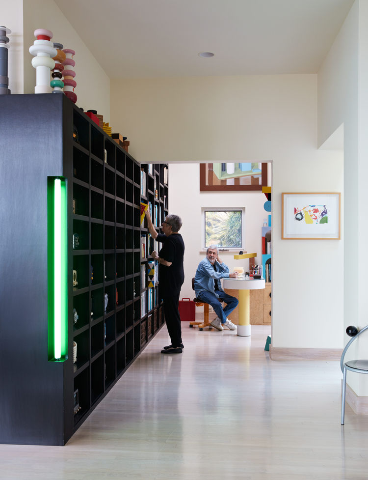Ettore Sottsass designed a shelving unit around the couple's large collection of vintage radios