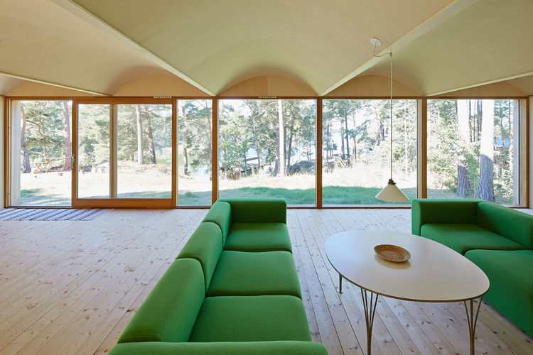Living room of Swedish retreat with sofas from Hay.