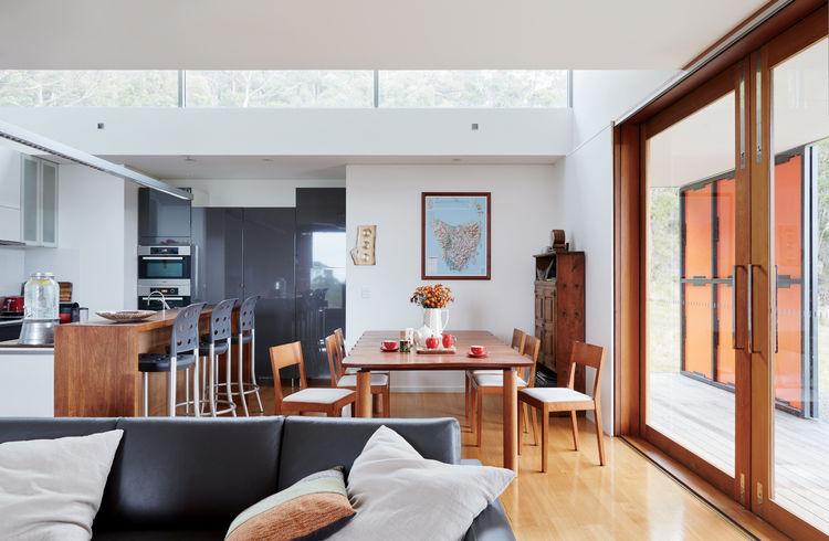 Blackwood dining table in Tasmanian prefab by Misho+Associates.