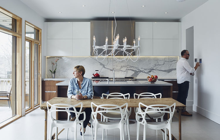 Modern Toronto kitchen and dining table outfitted with smart home technology