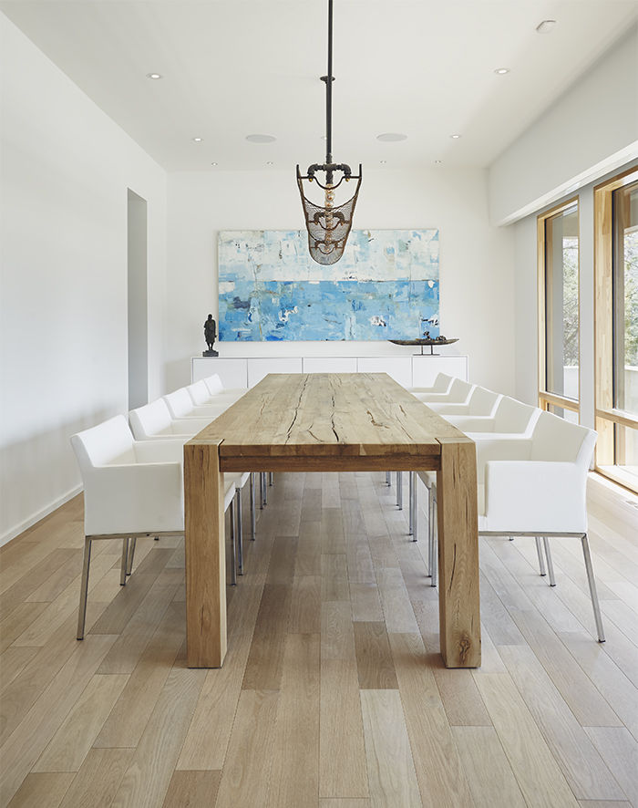 Modern dining room with white oak floors and a Restoration Hardware table