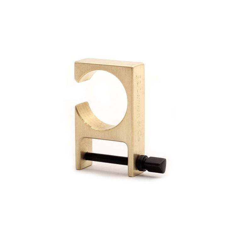 Multi-function key shackle and bottle opener made from machined brass