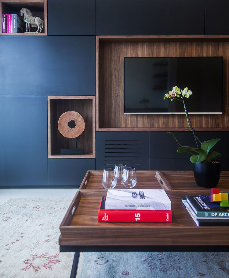 Custom media unit with wood in a Tel Aviv apartment