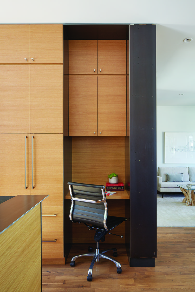Rift oak desk and storage space of San Francisco renovation and addition by Zack | de Vito Architecture + Construction.