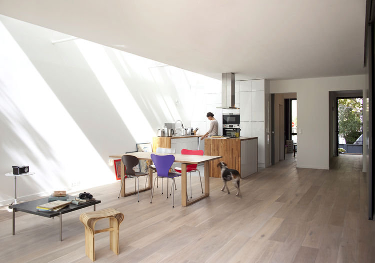 Kitchen and living area of eco-friendly prefab Paris home by Djuric Tardio Architectes