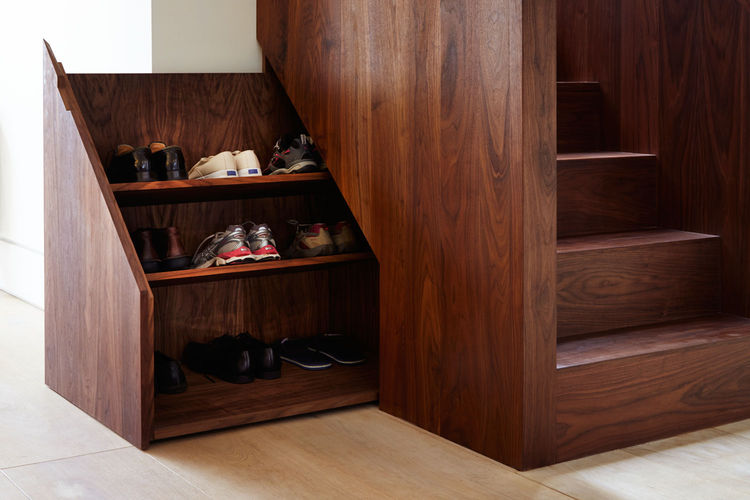 Lantern House shoe storage under staircase