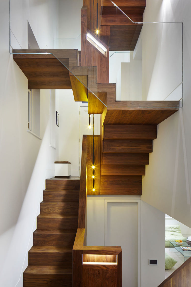 Black walnut staircase with Tom Dixon pendant lights