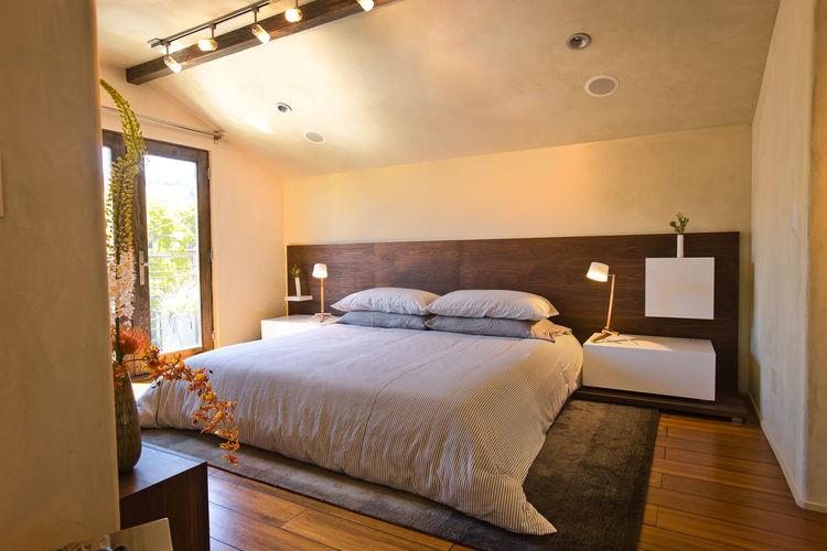Custom walnut headboard in a San Francisco master bedroom