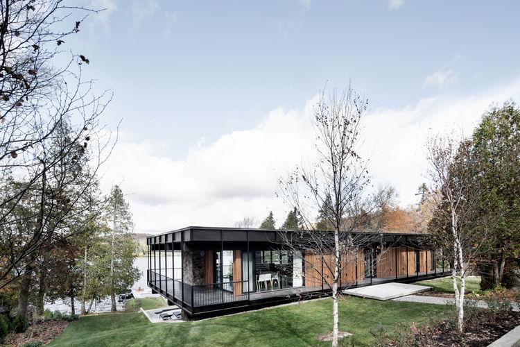 Midcentury Quebec home clad cedar, stone, and aluminum.