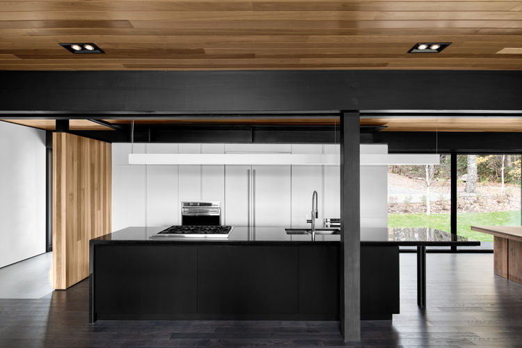 Kitchen with black countertops.