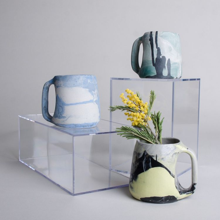 Colorful ceramic mugs handmade with marbled porcelain