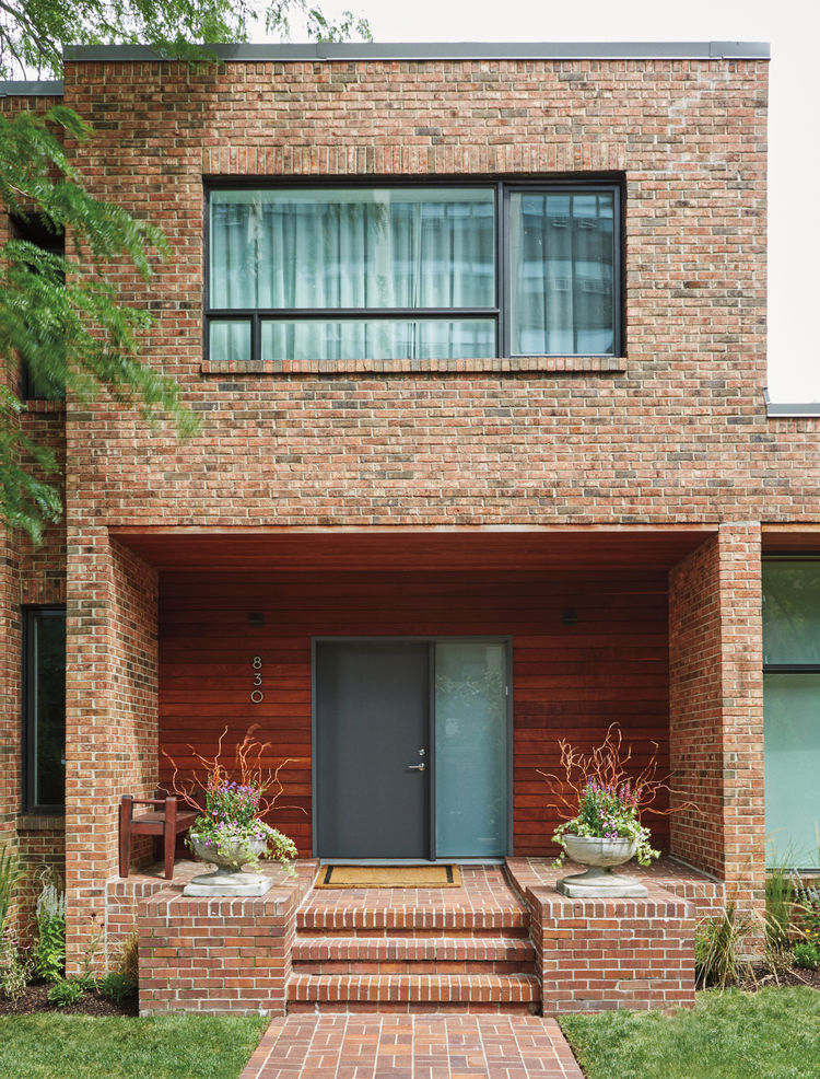 Ipe and brick exterior of Chicago renovation by dSPACE Studio.