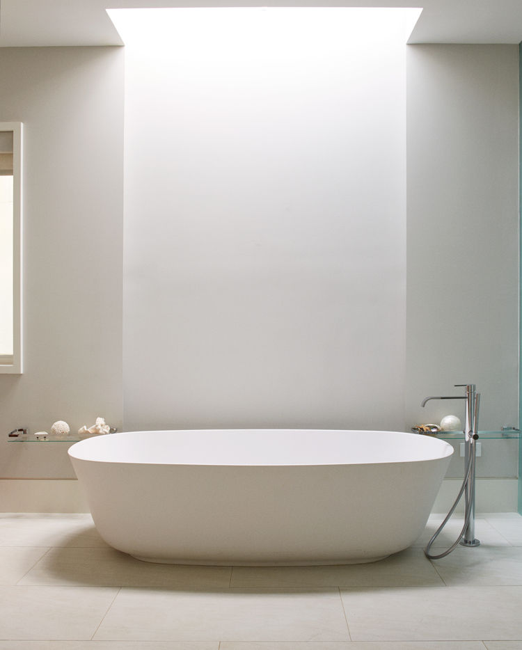 Antonio Lupi tub and skylight by Velux in bathroom of Chicago renovation by dSPACE Studio.