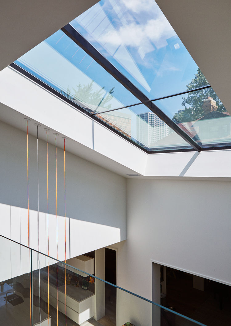Expanded skylight over living room of Chicago renovation by dSPACE Studio.