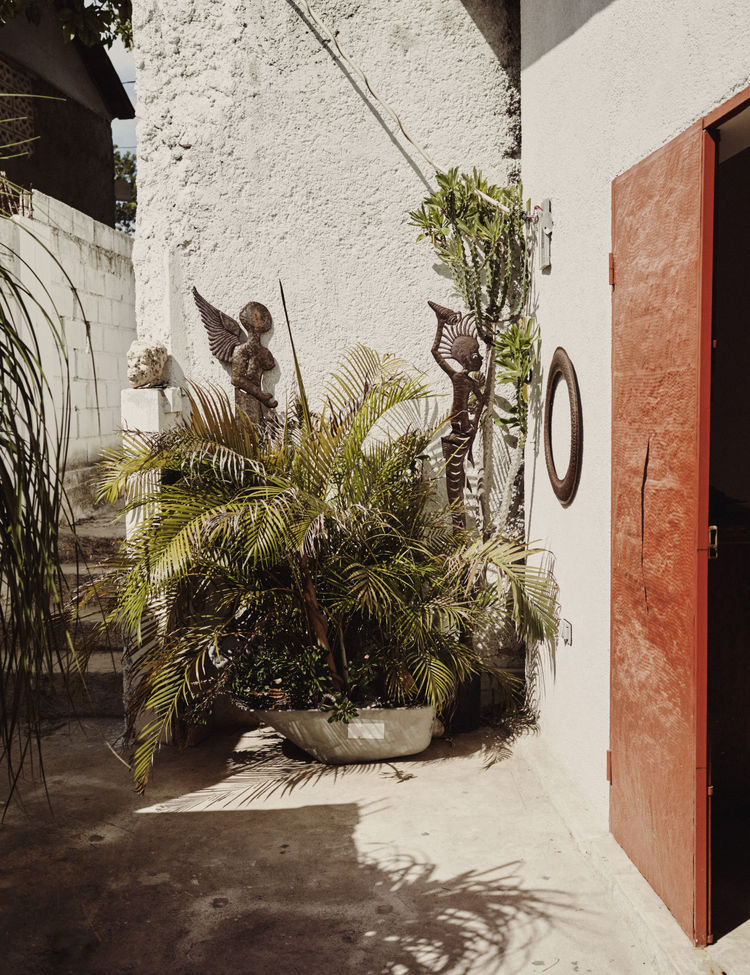 The entrance of a home in Haiti with sculptures