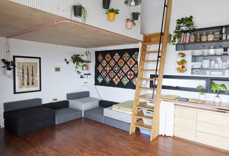 Modern artist studio with a living room loft mezzanine