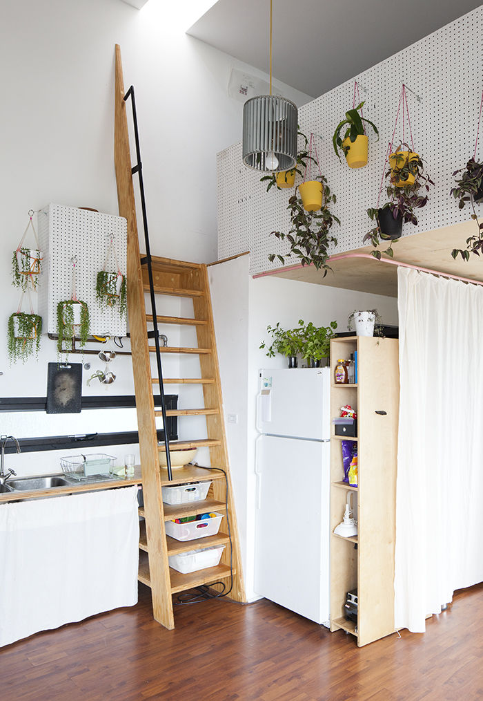 Kitchen leading to a loft in a modern artist studio