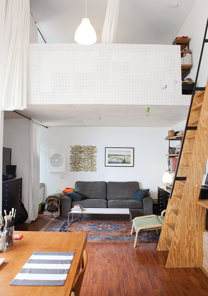 Living room underneath a loft in a micro-living unit