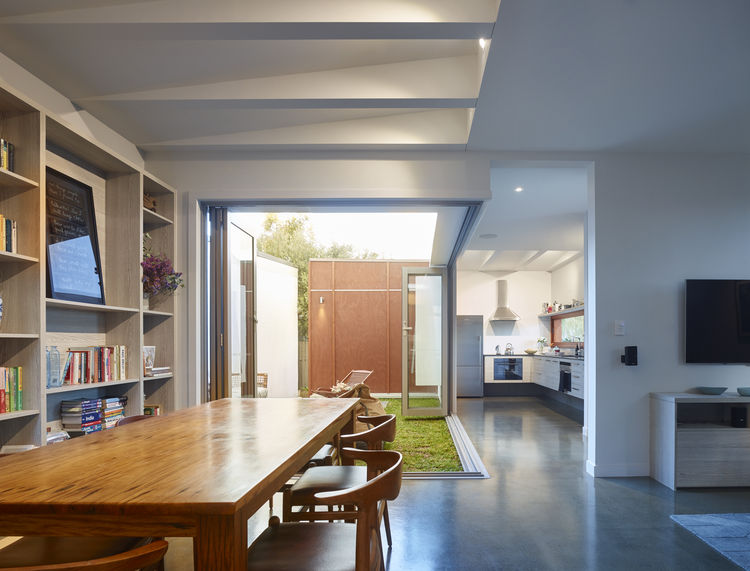 Fisher & Paykel refrigerator and QASAIR Heritage rangehood in kitchen of Brisbane home by O'Neill Architects.
