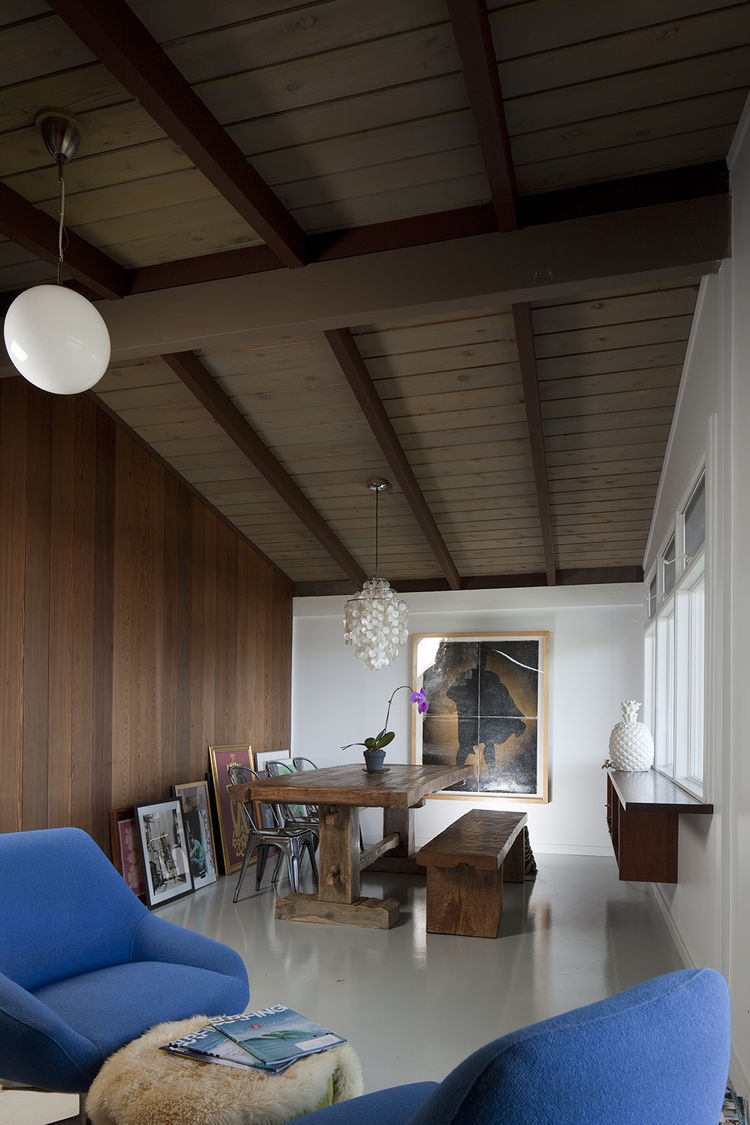Recycled teak table and IKEA pendant light in Hawaii renovation by Fritz Johnson Architect