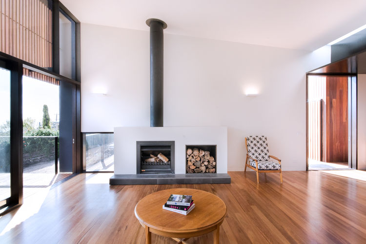 Jetmaster 700D wood-burning fireplace in living room of Australian beach home by OLA Studio