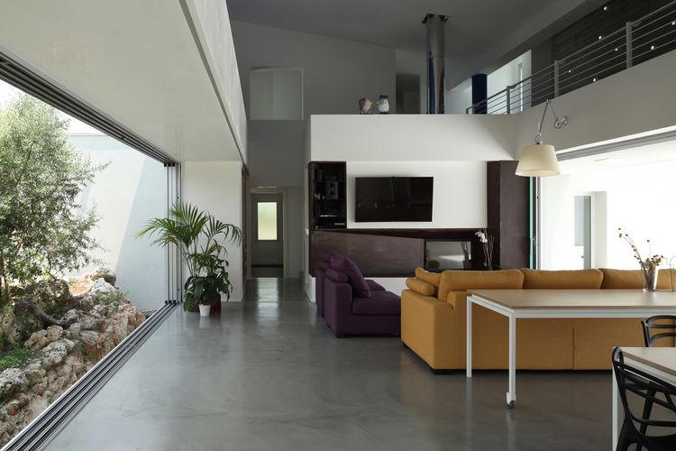Monochromatic interior with custom architect-designed furniture in Sicilian house by Fabrizio Foti