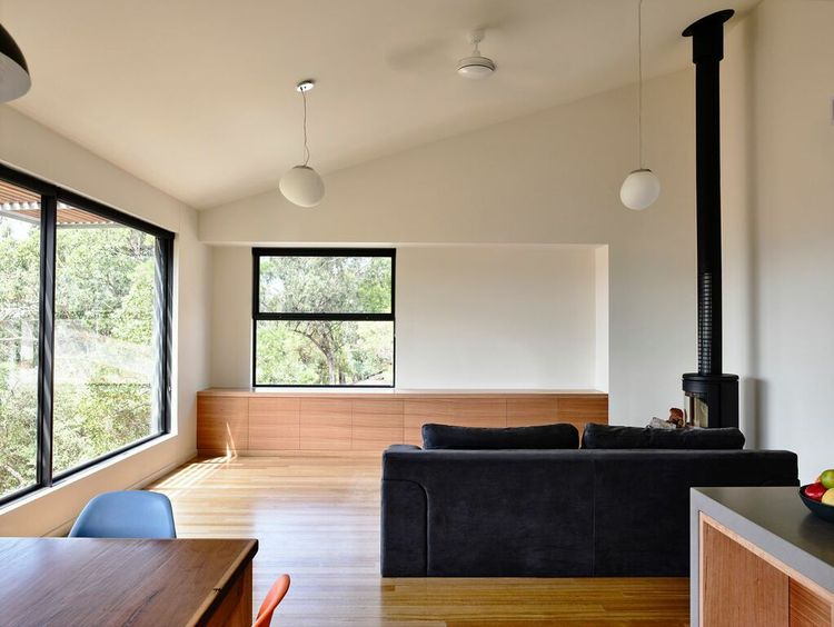 Minimal Australian living room with a wood-burning stove