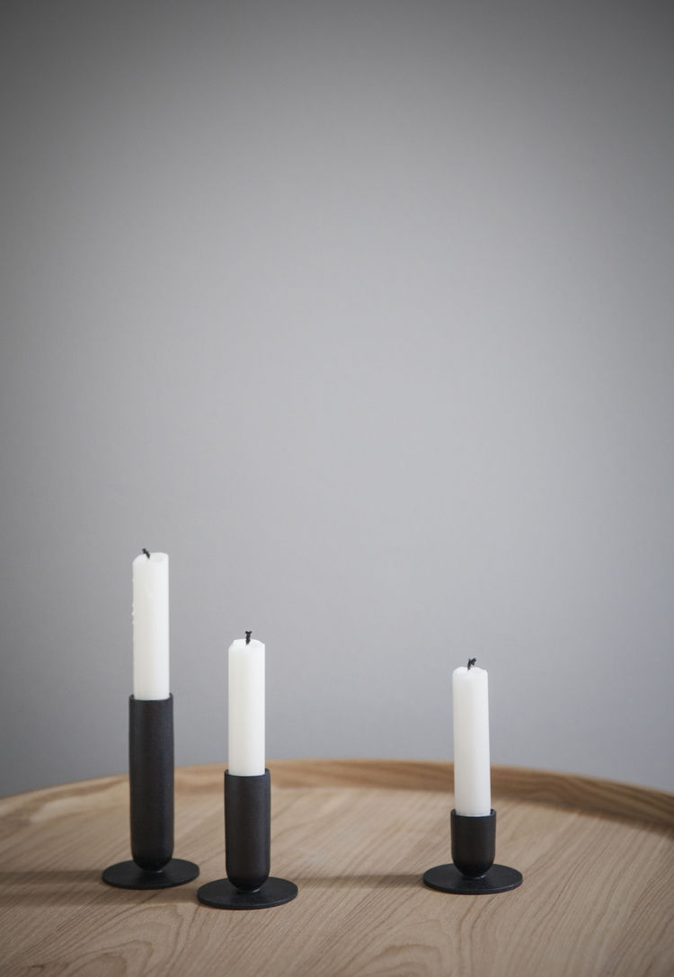 Trio of matte black candlestick holders in different sizes