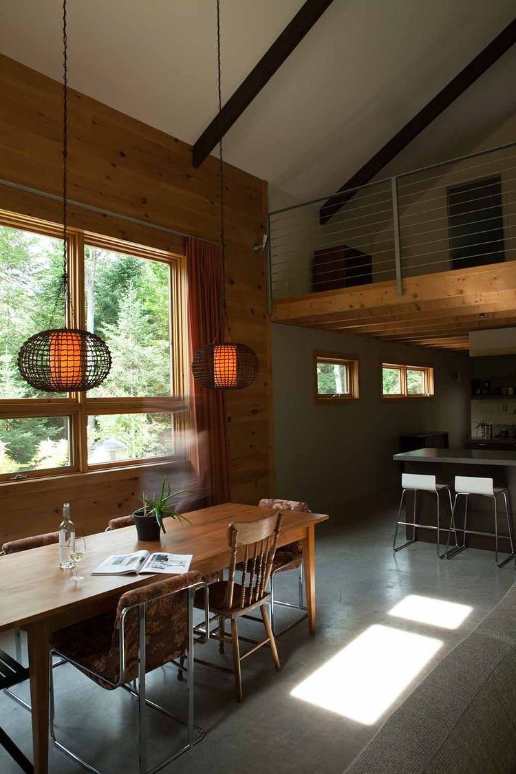 Quebec cabin wood dining room polished concrete floor.