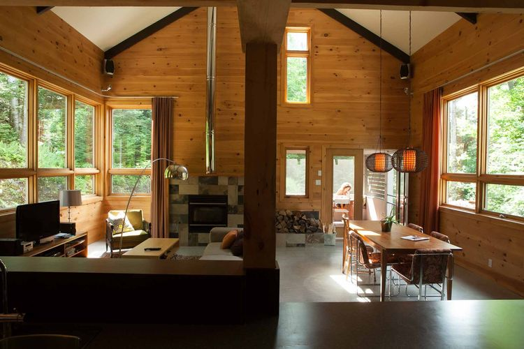 Quebec cabin wood interior living room and kitchen.