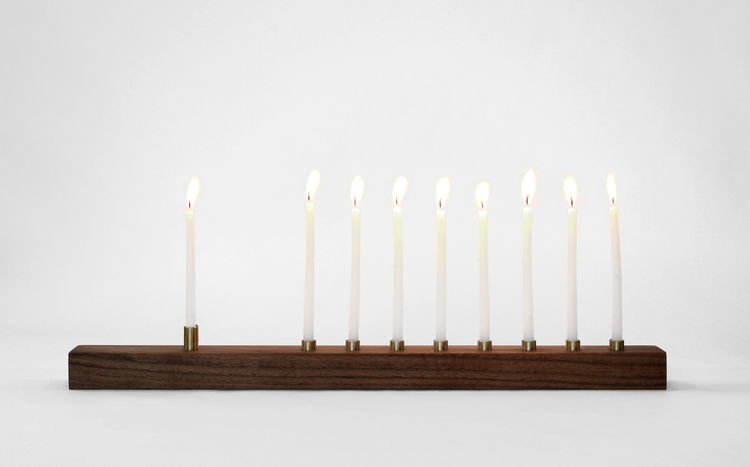 Sophisticated menorah made from walnut and bronze