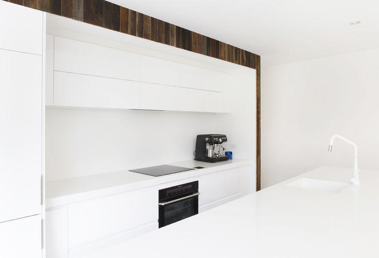 Winter-white kitchen in a renovated 1850s prefab cottage in Melbourne