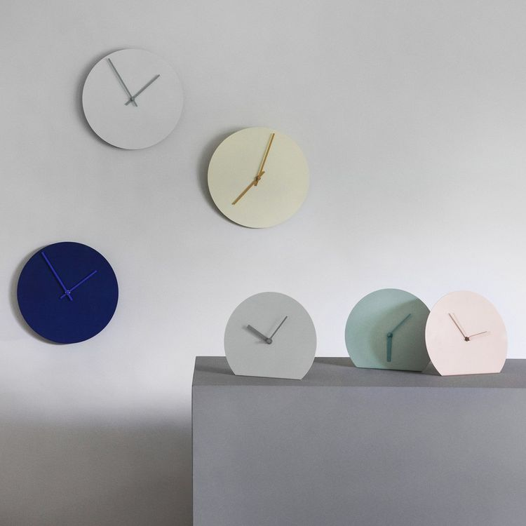 Minimalist table and wall clock in cool color pallete