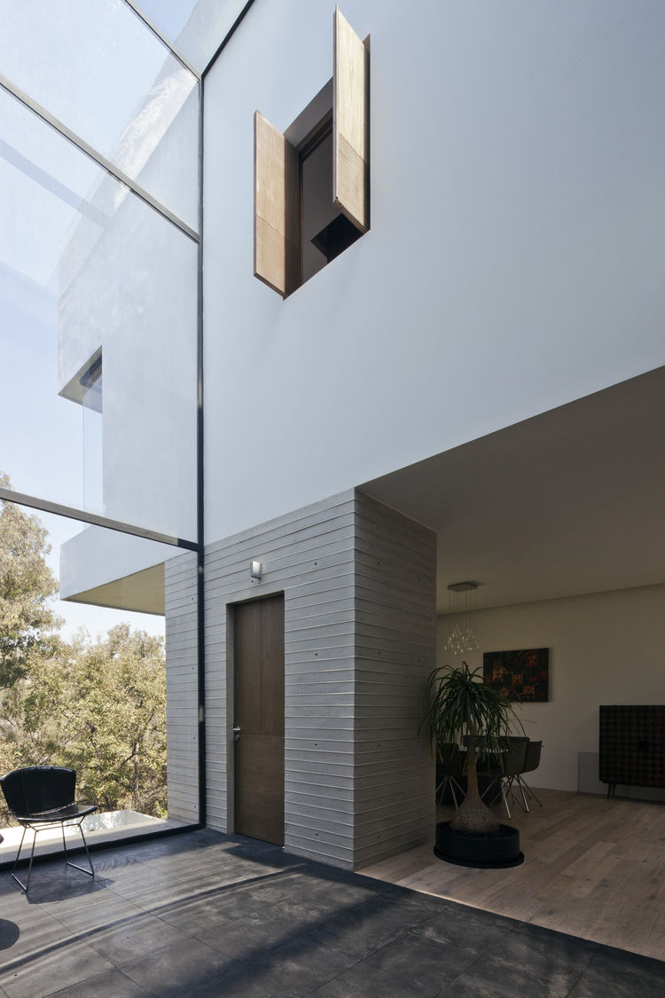 Glass wall in the landing at Casa U in a Mexico City suburb