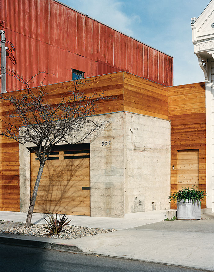 Modern San Francsico renovation with cedar and concrete garage and front entrance facade