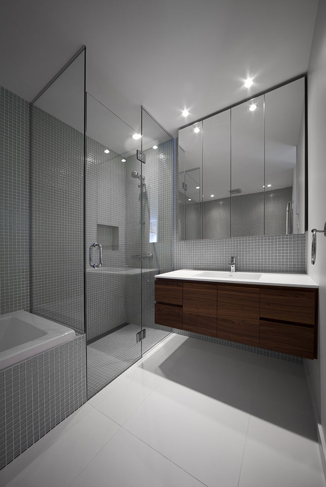 Bathroom with white tiles by Ciot in Montreal renovation by Blouin Tardif.