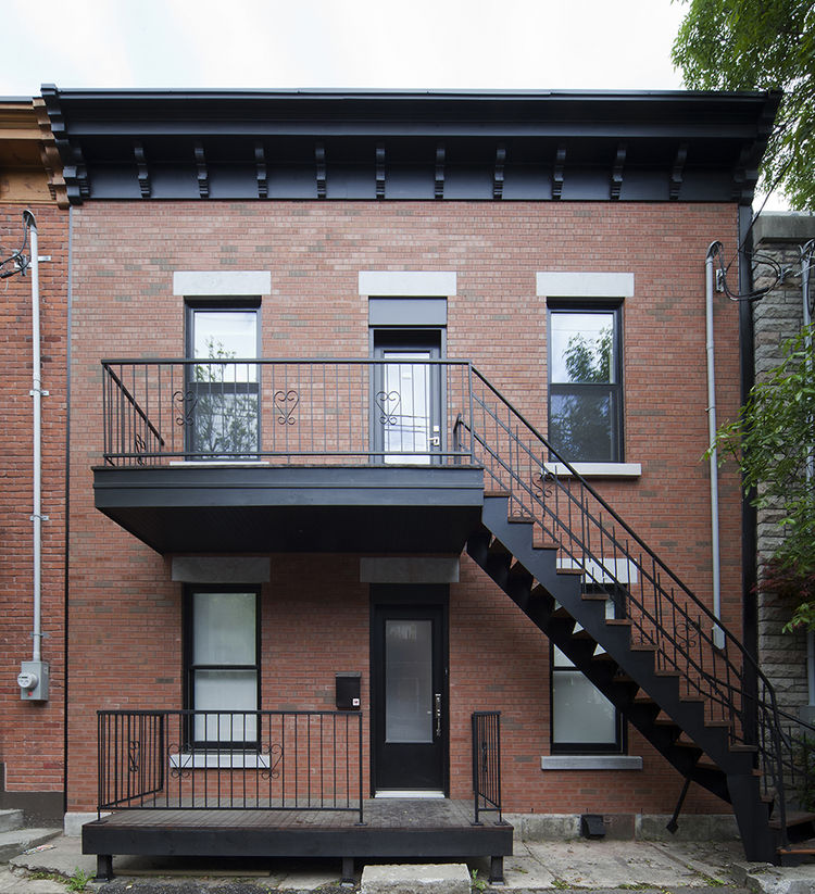 Traditional brick facade of Montreal renovation by Blouin Tardif.