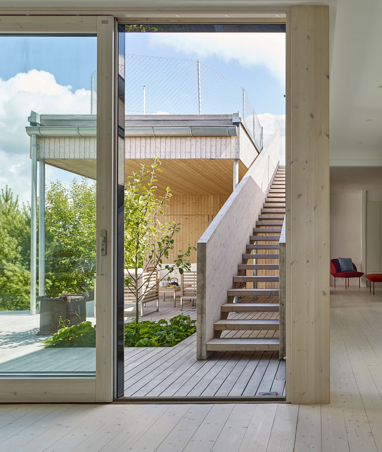 A staircase leads to a roof deck with striking views