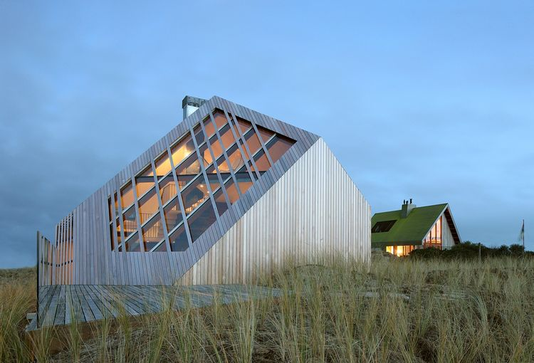 View of the Netherlands dune house at dusk
