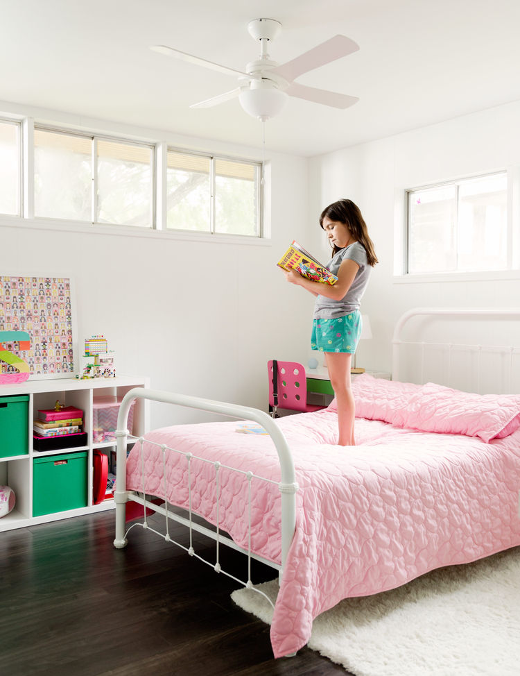 Pops of color make a bedroom perfect for the couple's young daughter.