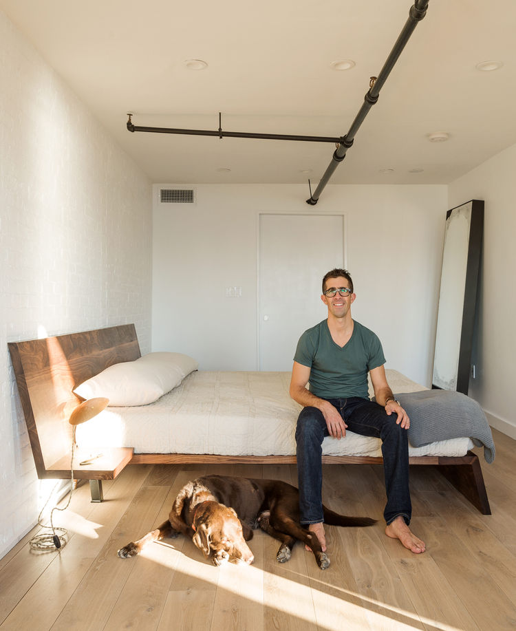 Custom wood bed by Asher Israelow and Table Light desk lamp by Lindsey Adelman.